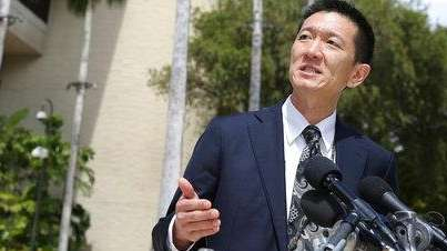 Hawaii Attorney General Douglas Chin speaks at a