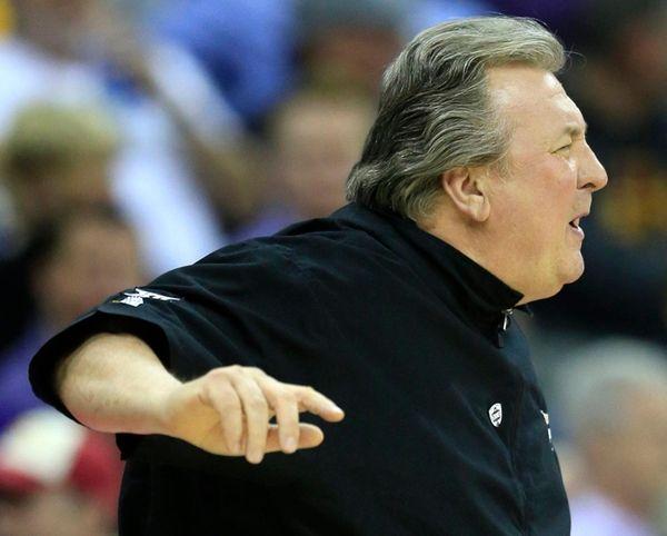 West Virginia head coach Bob Huggins yells for