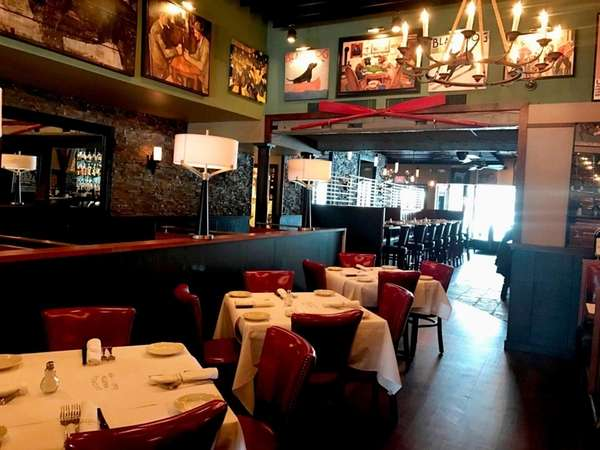 George Martin 1989 opens for business in Syosset.