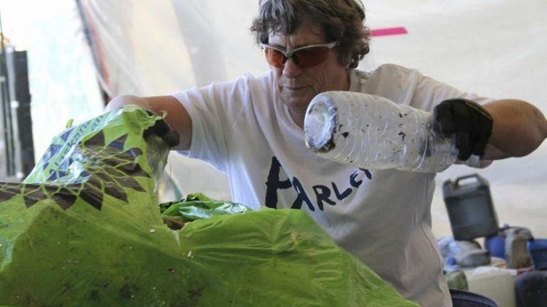 Stefanie Coppock helps sort marine debris Tuesday, July