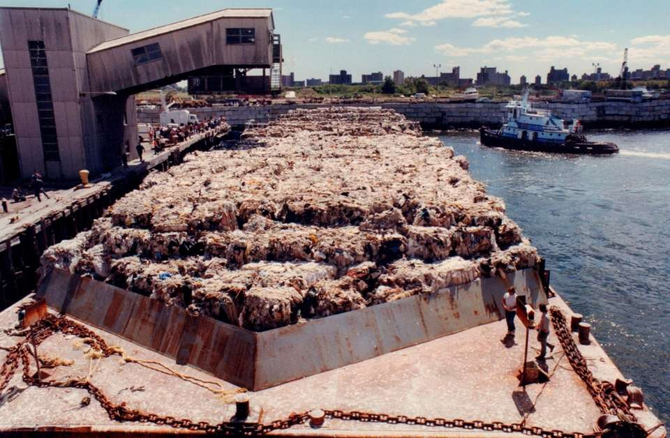 Overall view of the Islip garbage barge tied