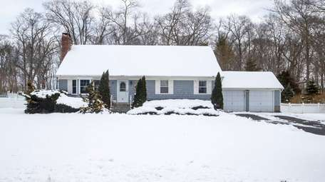 This three-bedroom, two-bath cape in Aquebogue is on