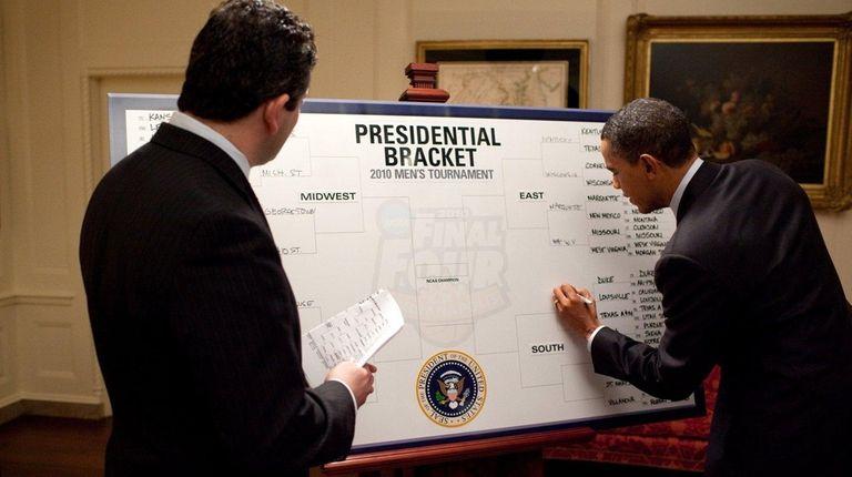 ESPN's Andy Katz watches as President Barack Obama