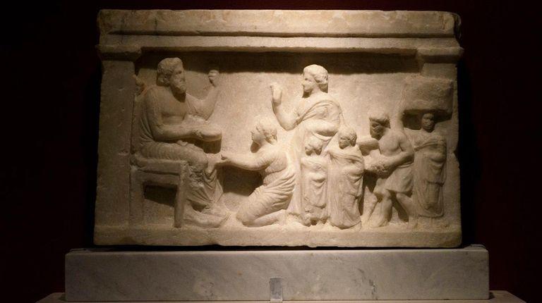 A marble votive relief of Greek mythology hero
