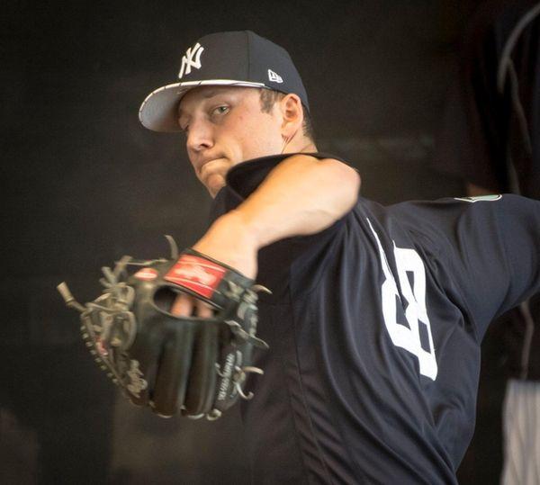 New York Yankeespitcher James Kaprielian throwsin the bullpen