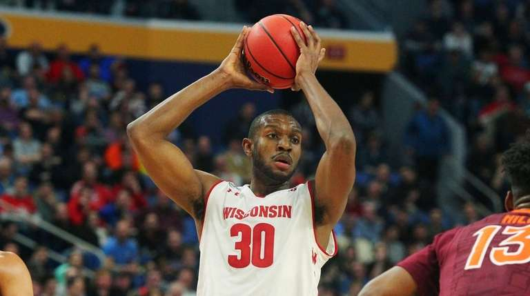 Wisconsin forward Vitto Brown (30) looks to pass