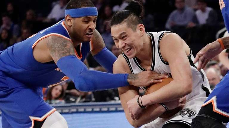 The Nets' Jeremy Lin plays keepaway from the