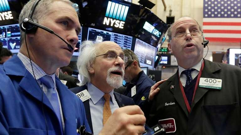 Traders Timothy Nick, left, Peter Tuchman, center, and