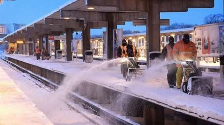 Long Island Rail Road personnel work to clear