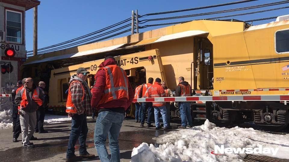 LIRR crews investigate the scene where two work