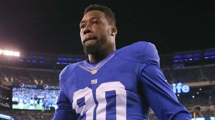 Giants defensive end Jason Pierre-Paul greets fans before