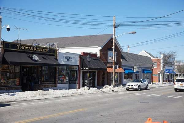 Small shops line Port Jefferson's Main Street, which