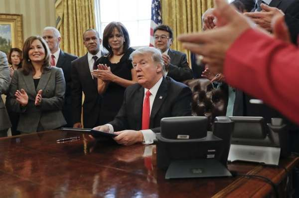 Donald Trump at his desk in the White