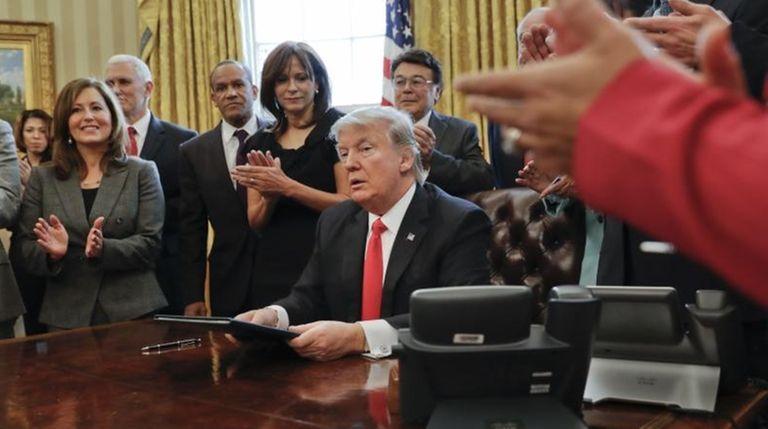 Donald Trump at his desk in the White