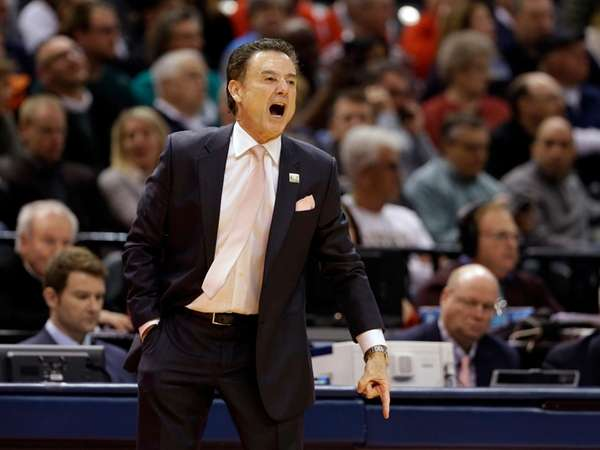 Louisville head coach Rick Pitino yells to his