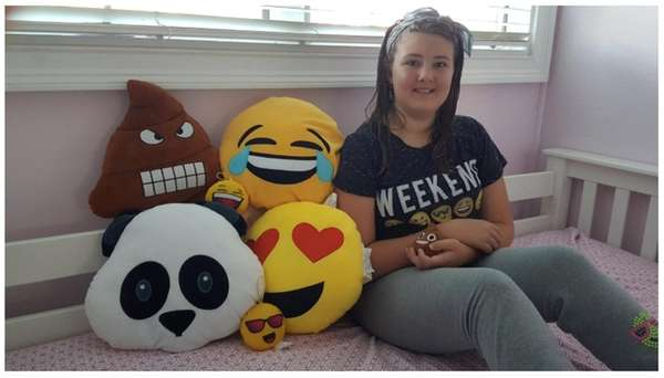 Kidsday reporter Amabelle Flannery with her emoji pillows.