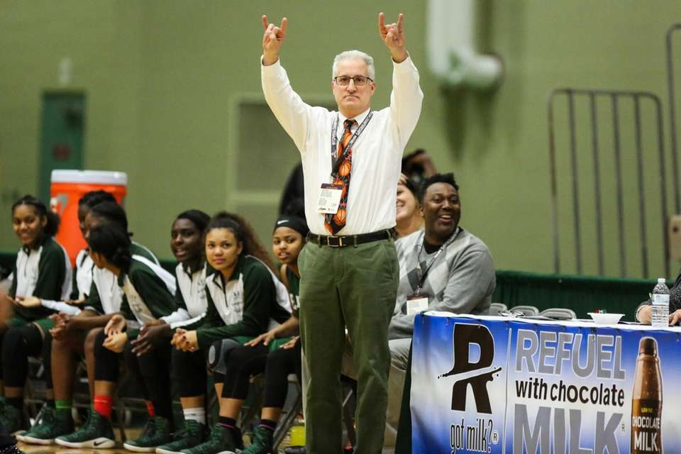 Elmont's Head Coach Tom Magno gives signs to