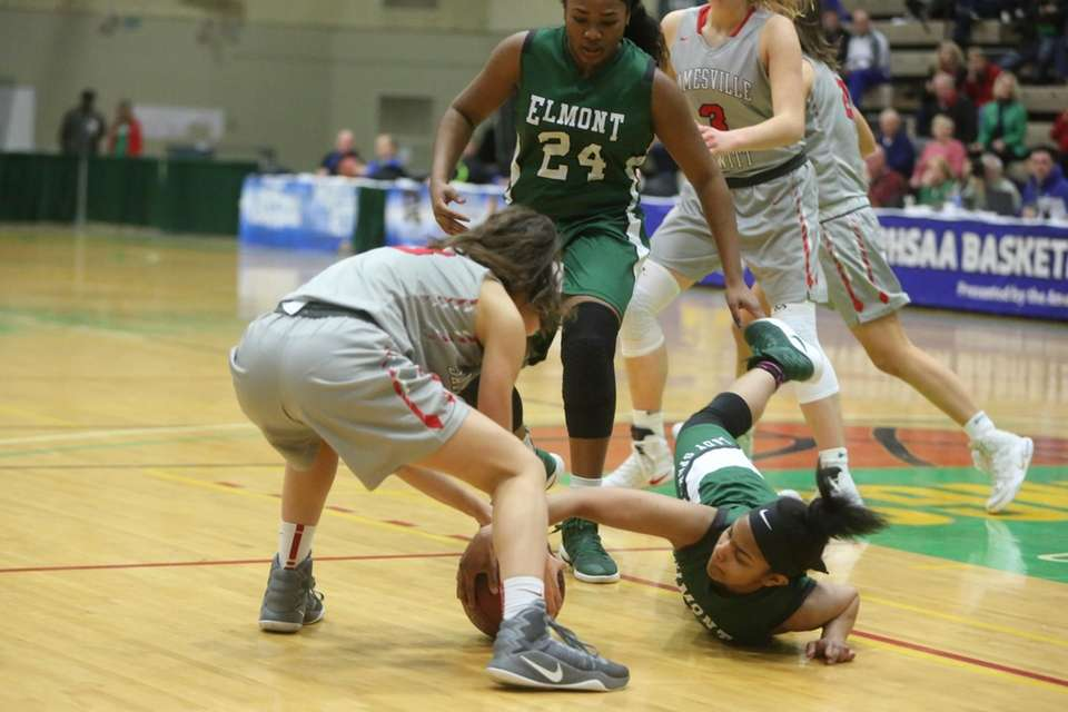 Elmont's Zhaneia Thybulle (15) goes after the loose