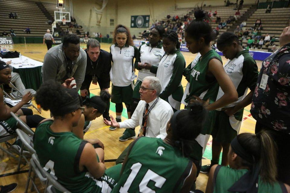 Elmont's Head Coach Tom Magno talks to his