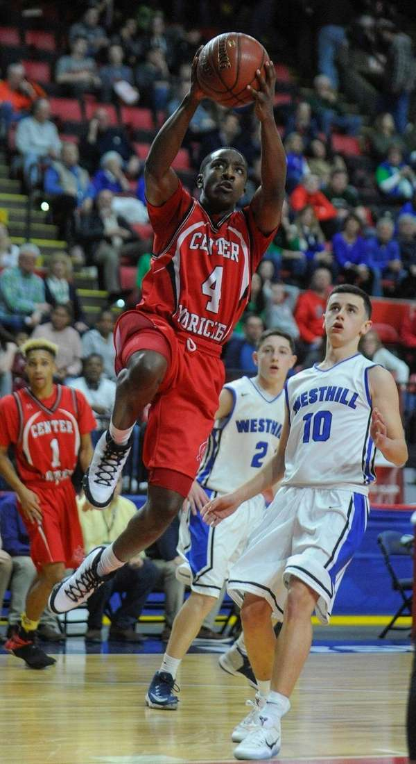 Red Devils' Troy Goode attempts layup against Westhill