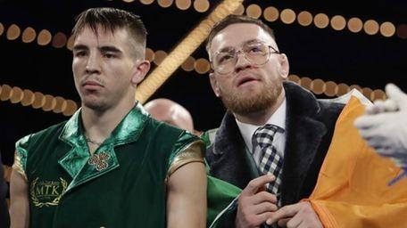 Ireland's Conor McGregor, right, and Michael Conlan stand