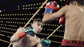 Michael Conlan, left, of Ireland, fights Tim Ibarra