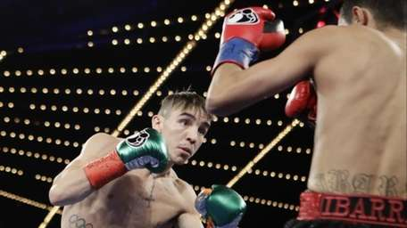 Michael Conlan, left, of Ireland, fights Tim Ibarra