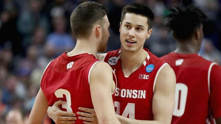 Teammates Zak Showalter #3 and Bronson Koenig #24
