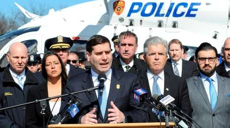 Suffolk County Police Commissioner Timothy Sini speaks at