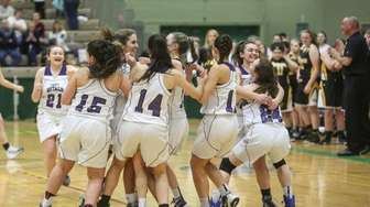 Port Jefferson players celebrated after defeating South Seneca,