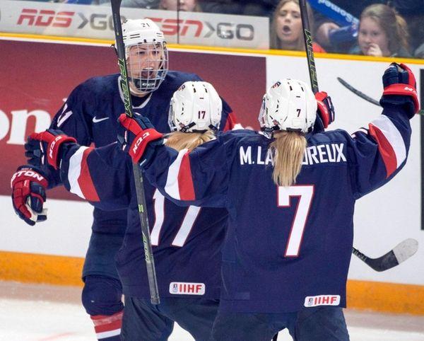 Team USA's Hilary Knight, left, celebrates with teammates