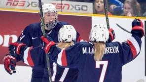Team USA's Hilary Knight, left, celebrates with teammates