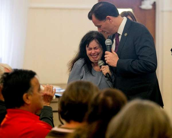 Rep. Tom Suozzi (D-Glen Cove) comforts Andrea Ornstein
