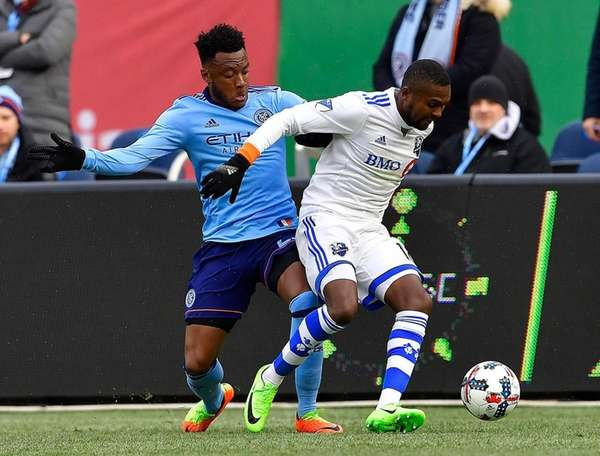 NYC FC's Rodney Wallace pursues Montreal's Chris Duvall