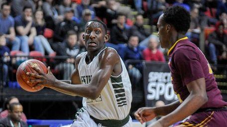 Westbury's Isaiah Bien-Aise, left, drives to the basket