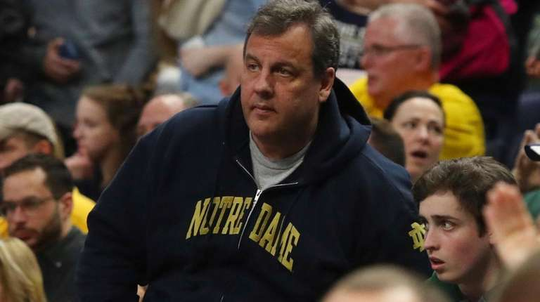 New Jersey governor Chris Christie watches the action
