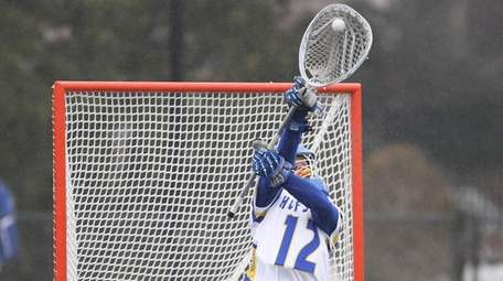 Hofstra's Jack Concannon (12) makes a save in
