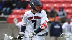 Stony Brook midfielder Alex Corpolongo drives to the