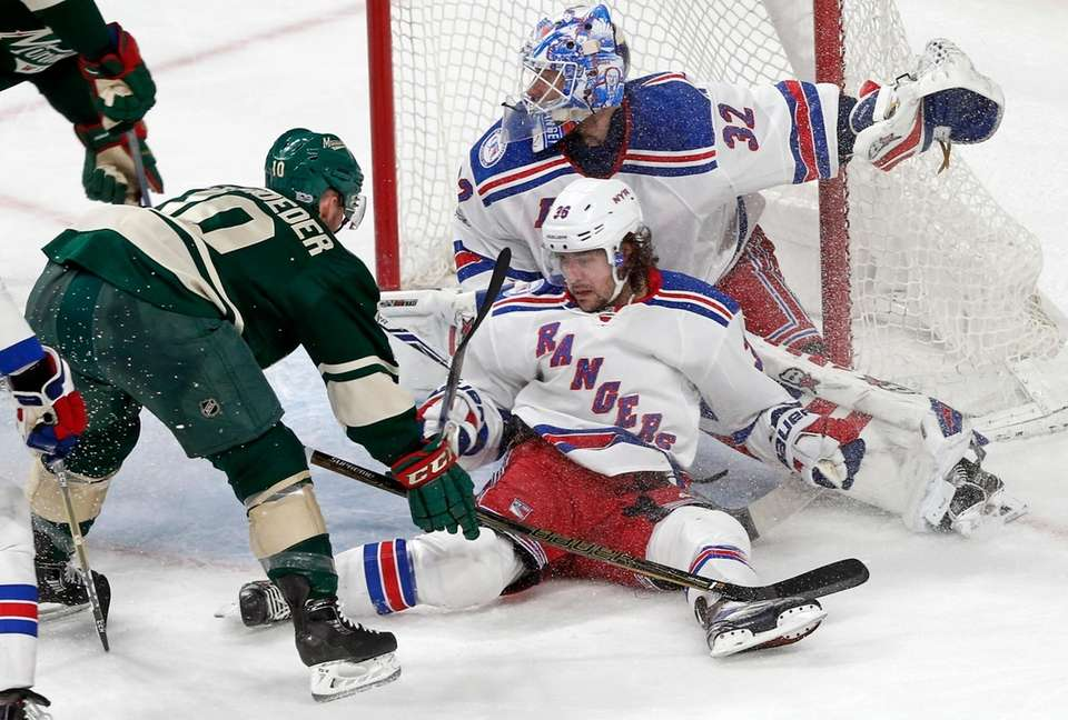 New York Rangers' Mats Zuccarello falls against goalie