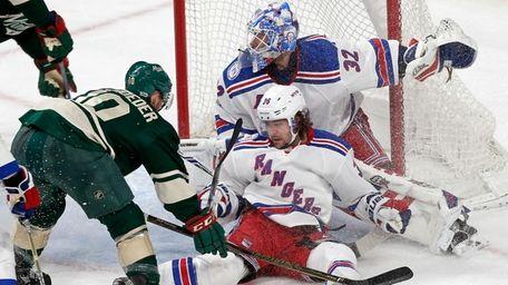 New York Rangers' Mats Zuccarello falls against goalie