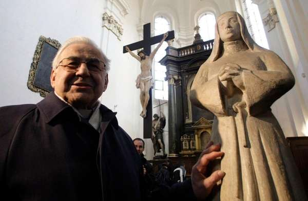 Cardinal Miloslav Vlk by a statue of St.