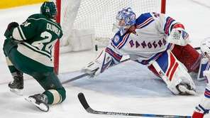 Minnesota Wild's Matt Dumba, left, scores on New