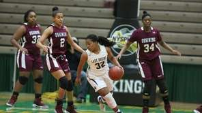 Baldwin's Montia Moon (32) moves around Ossining Andra