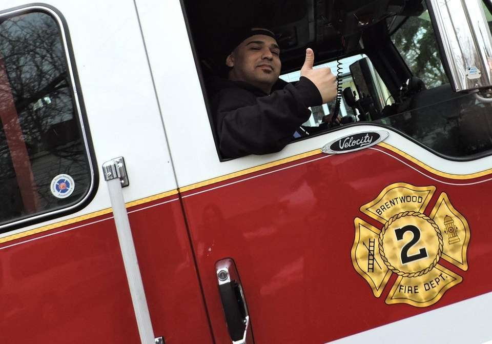 A member of the Brentwood Fire Department greets
