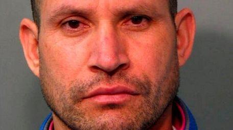 Fredys Santamaria, 39, of Westbury was arrested by