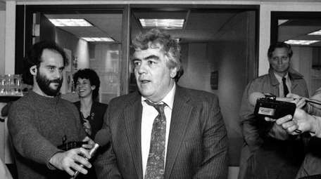 Jimmy Breslin speaks to reporters in the New