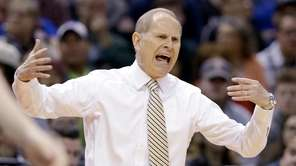 Michigan head coach John Beilein questions a call