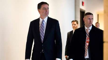 FBI director James Comey, left, leaves a meeting