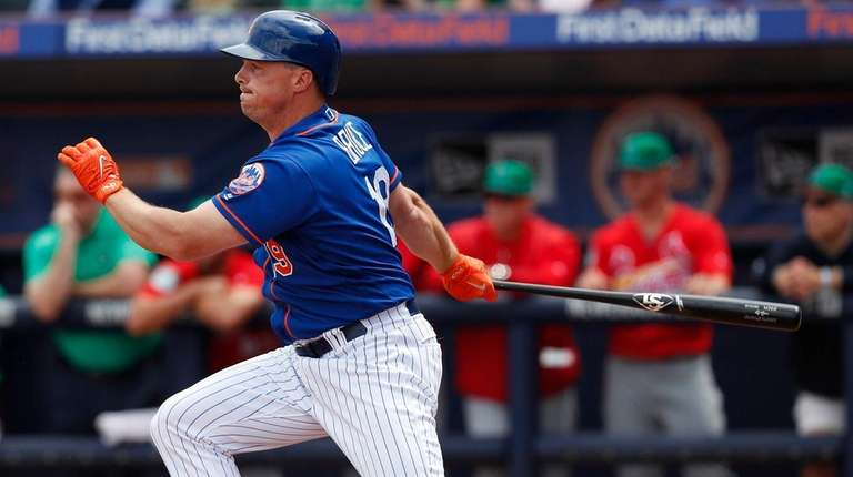 New York Mets' Jay Bruce (19) drives in