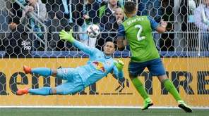 Seattle Sounders forward Clint Dempsey (2) scores a